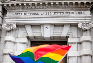 iStock_courthouse and lgbt flag